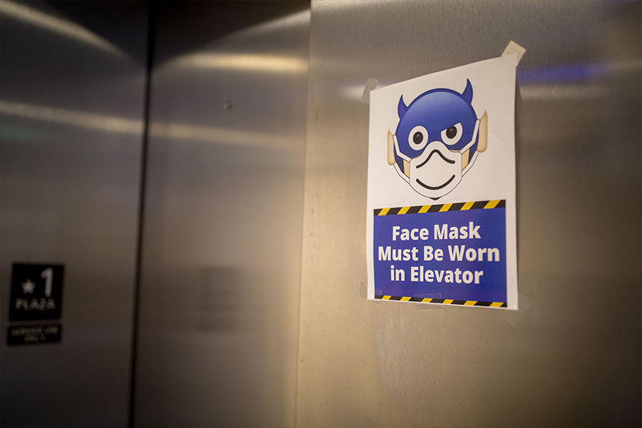 "Elevator with ""Face Mask Must Be Worn in Elevator"" sign"